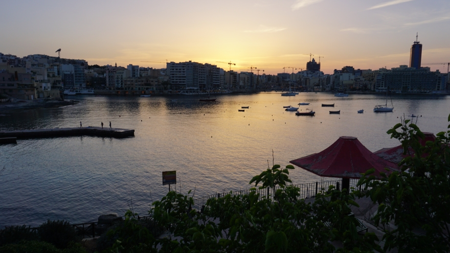 Sunset over bay in Malta St. Julian