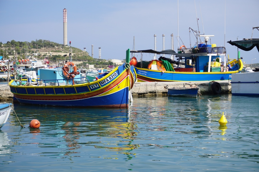 Typical Maltese boat colorful laying in harbor