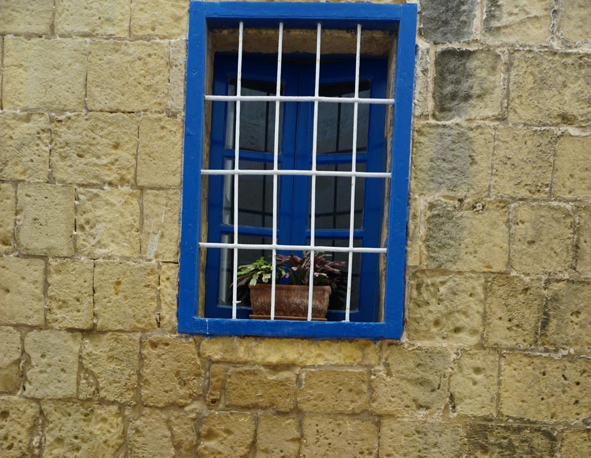 Blue window in wall historic icon Gozo Malta