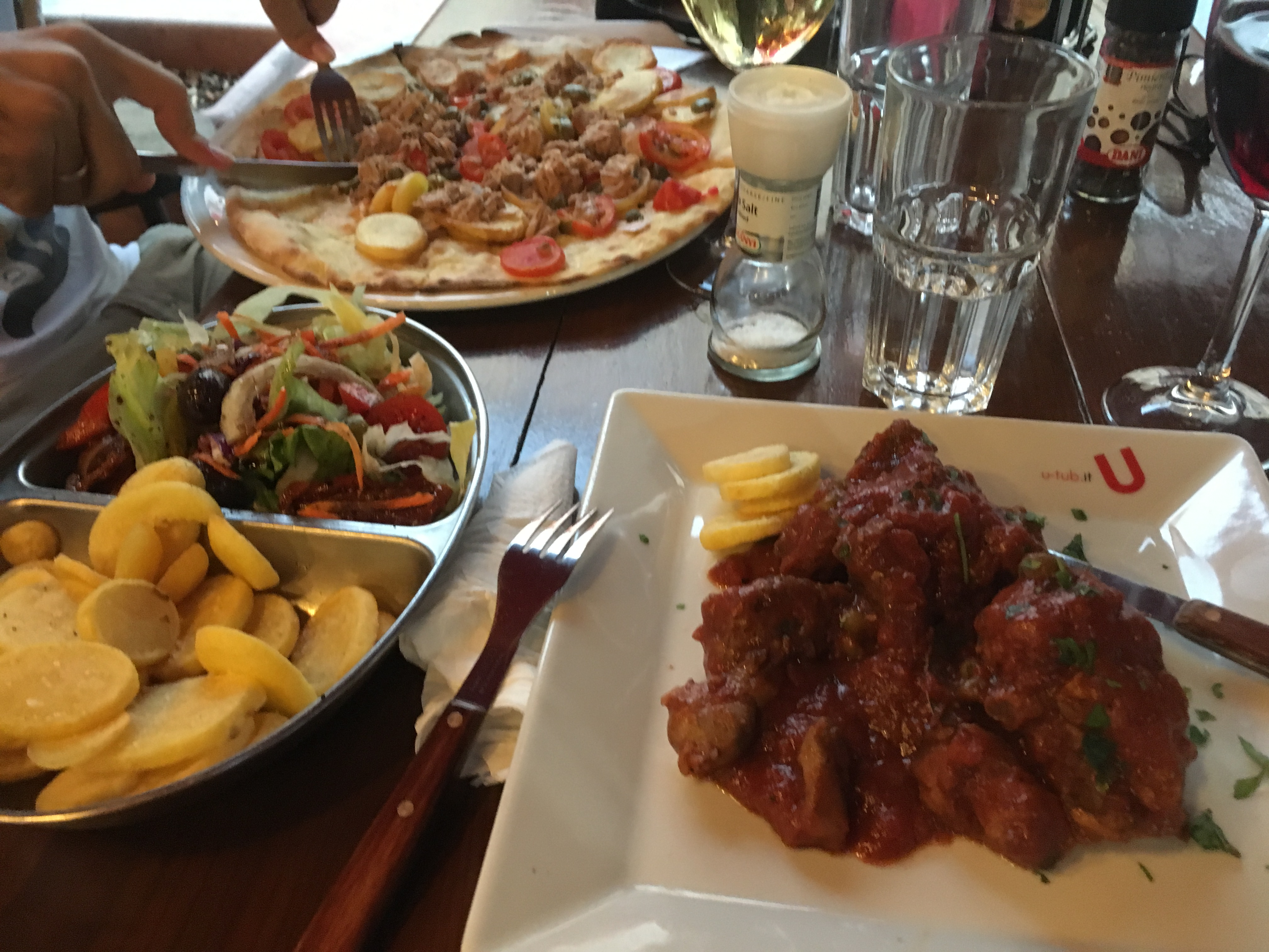 Maltese food, pizza and rabbit potatoes and wine