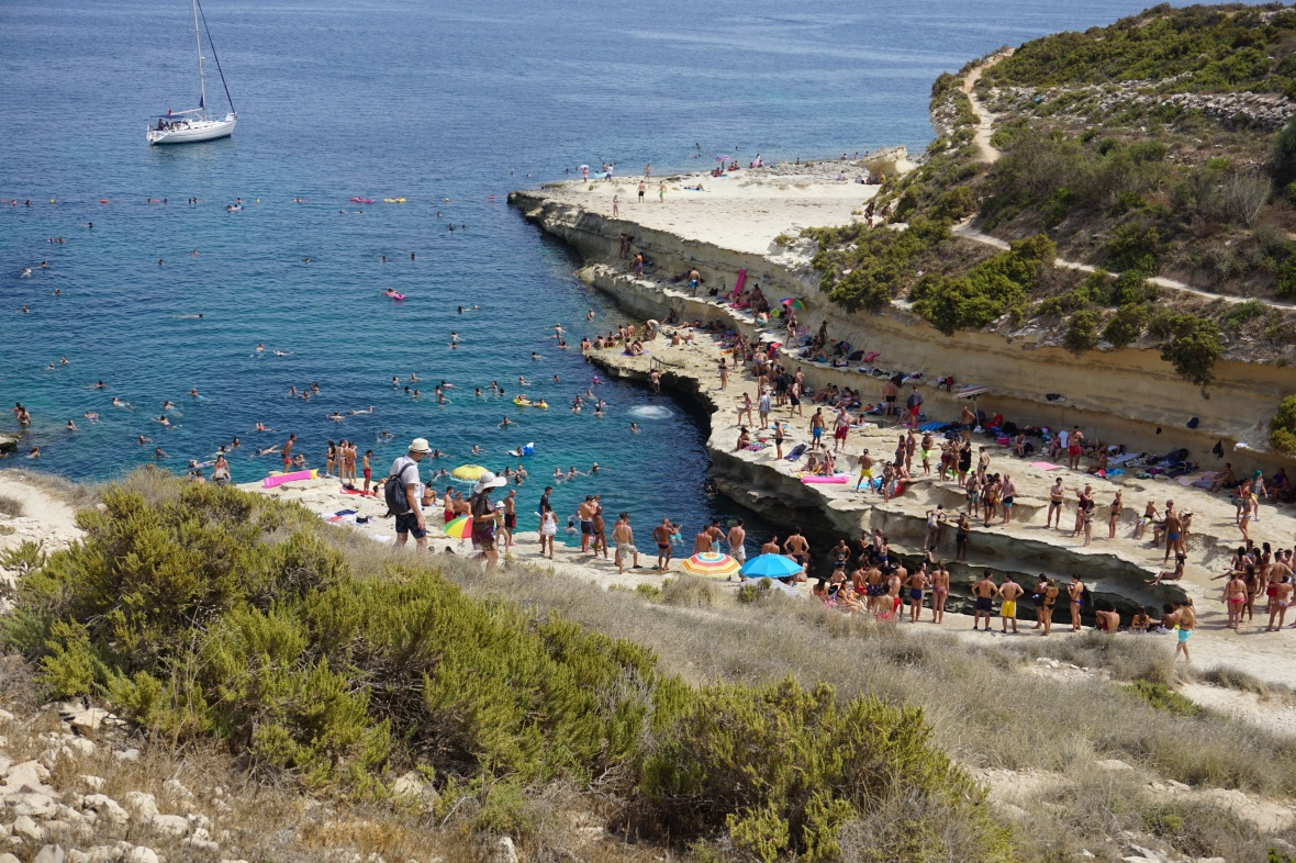 Pool, coast In Malta , people on beach