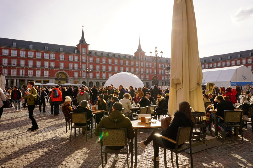 People sitting at plaza mayor in Madrid