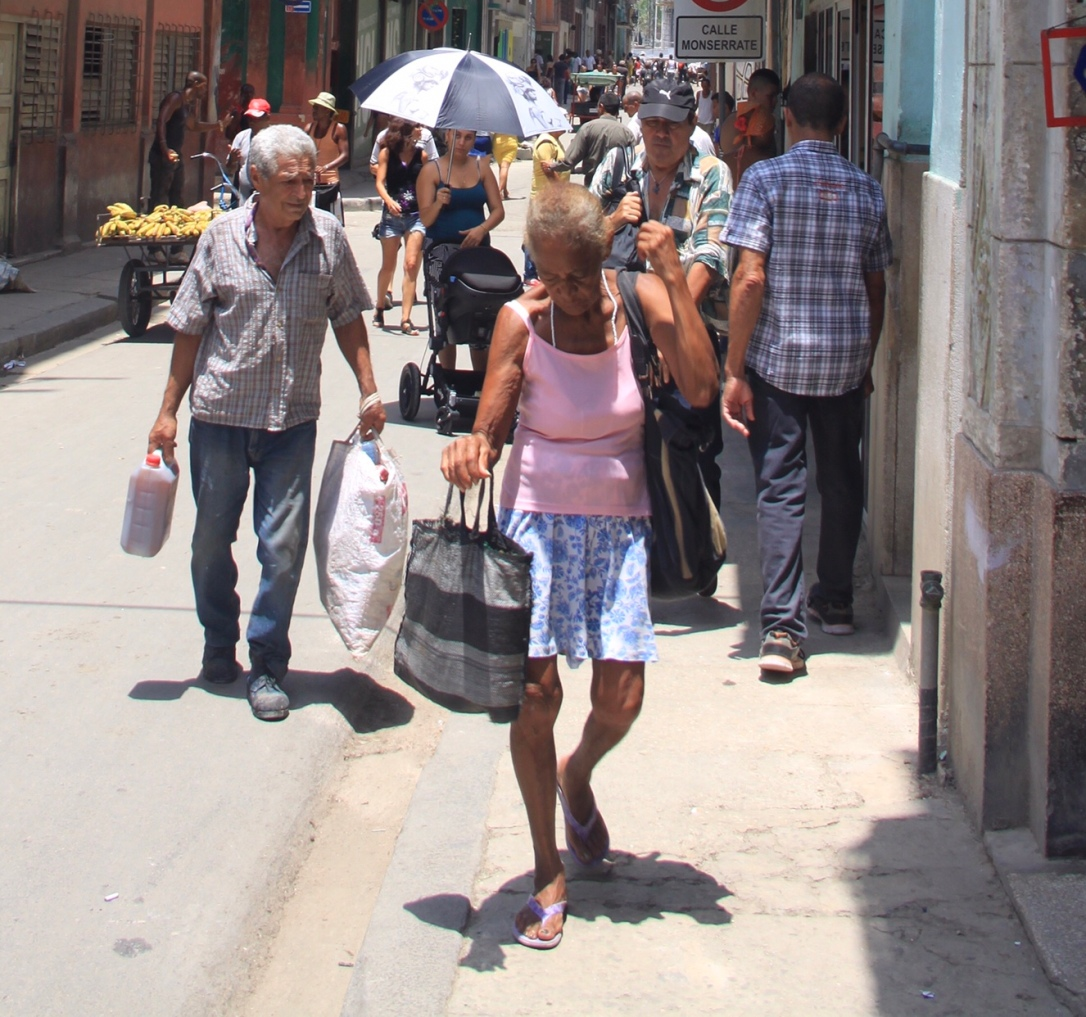 Woman walking in the streets of Havana