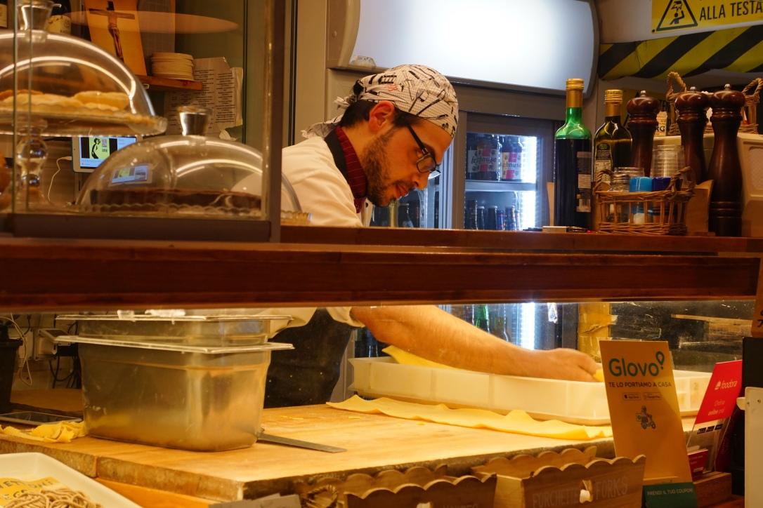 Man making handmade pasta in Rome